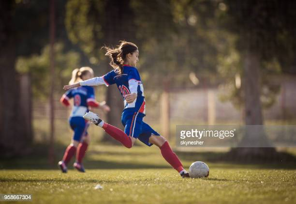 teenage soccer player in action on a playing field. - women's football stock pictures, royalty-free photos & images
