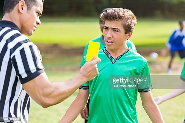 Teenage soccer player is upset over referee's call