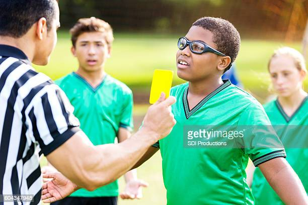 teenage soccer player upset with referee's call - yellow card stock pictures, royalty-free photos & images