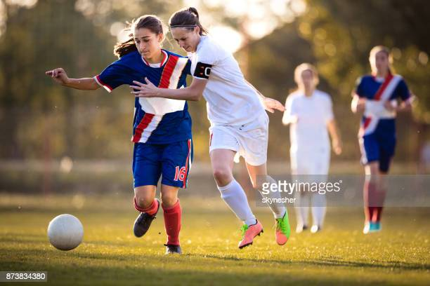 Teenage soccer players feeling determined on a match.