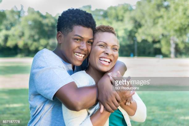 teenage son hugs his mom - mother and son stock photos and pictures