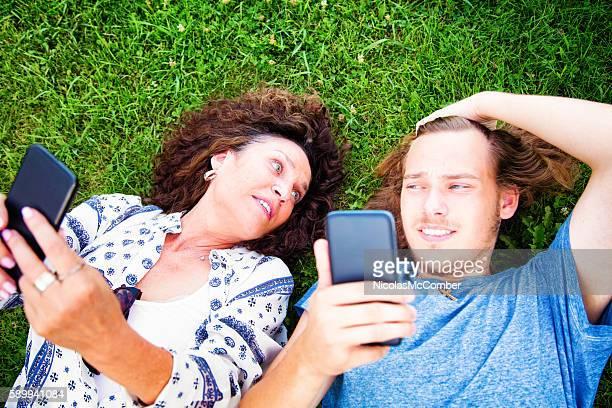 Teenage son unimpressed at mother handling mobile phone