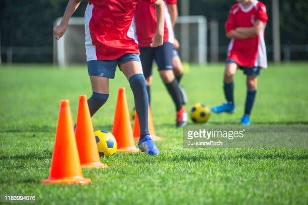 teenage spanish footballers practicing drills with cones - sports training camp stock pictures, royalty-free photos & images