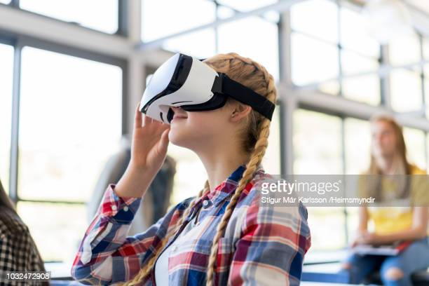teenage student wearing virtual reality glasses - cyberspace stock pictures, royalty-free photos & images