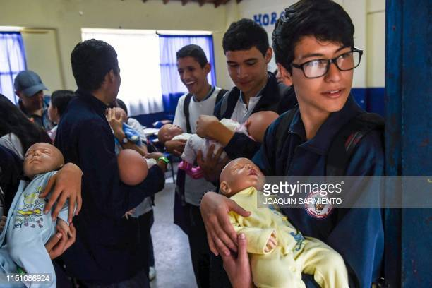 Teenage students carry baby robots during a break at a school in Caldas Antioquia's department Colombia on May 17 2019 Schoolchildren in Caldas...