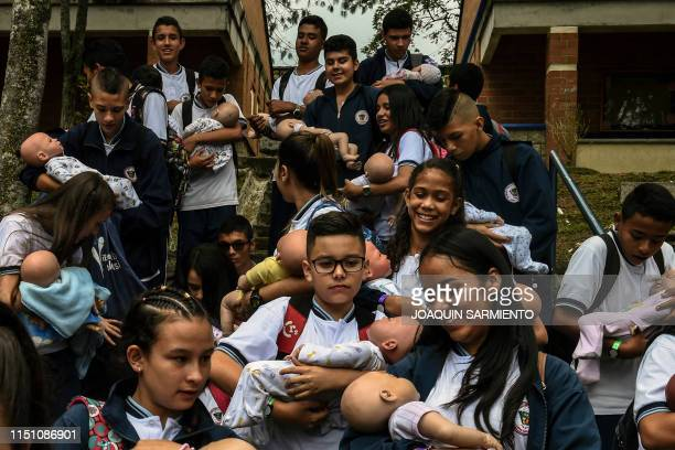 TOPSHOT Teenage students carry baby robots during break at a school in Caldas Antioquia«s department Colombia on May 17 2019 Schoolchildren in Caldas...