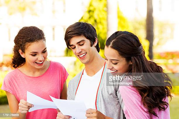teenage students checking test results on college campus - day stock pictures, royalty-free photos & images