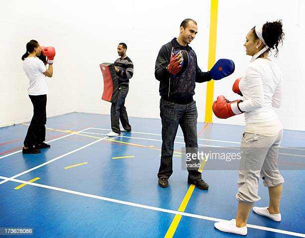 teenage students in a self defense class - physical education stock photos and pictures