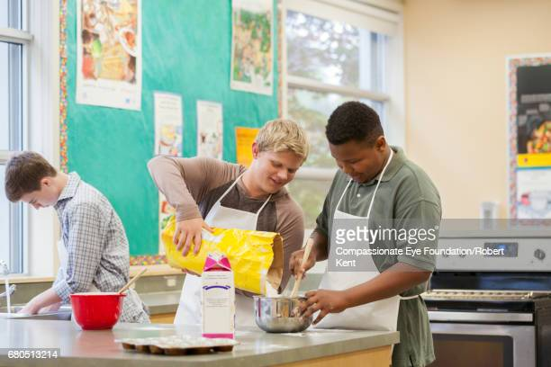 Teenage students in cookery class