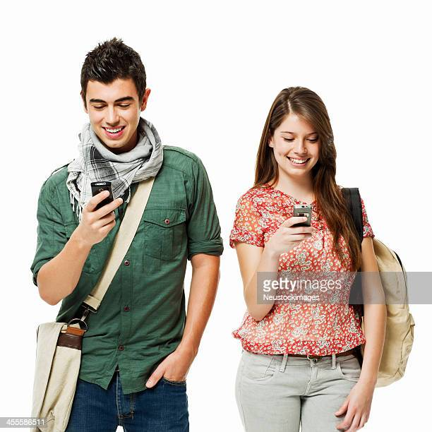 Teenage Students on Cellphones - Isolated