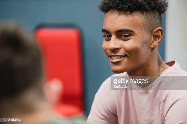 teenage students talking in lesson - teenagers only stock pictures, royalty-free photos & images