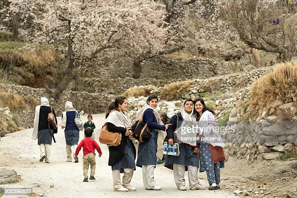 Teenage students with appricot and cherry blossom at Hunza, Pakistan