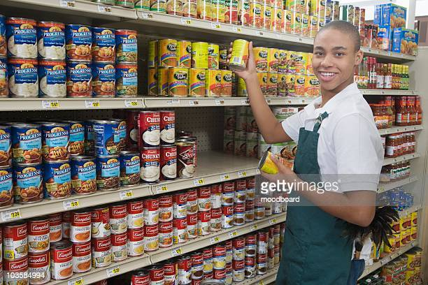 teenage supermarket employee - canned food stock pictures, royalty-free photos & images