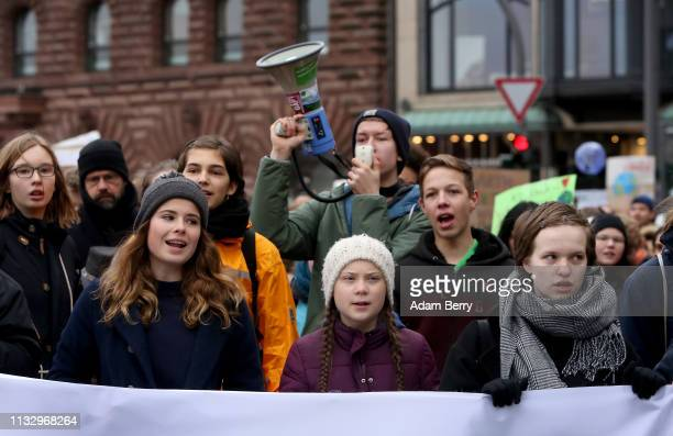 Teenage Swedish activist Greta Thunberg and German activist and organizer Luisa Neubauer march with high school students against global warming at a...