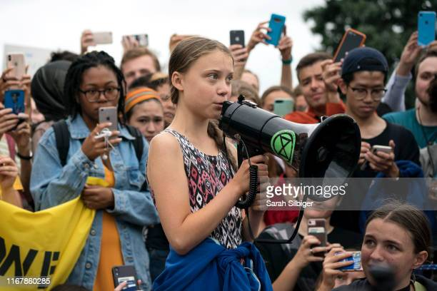 Teenage Swedish climate activist Greta Thunberg delivers brief remarks surrounded by other student environmental advocates during a strike to demand...