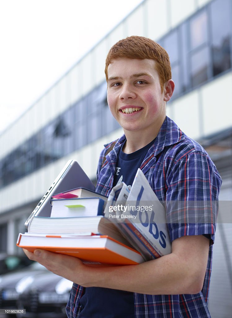 Teenage university student with jobs news paper : Stock Photo