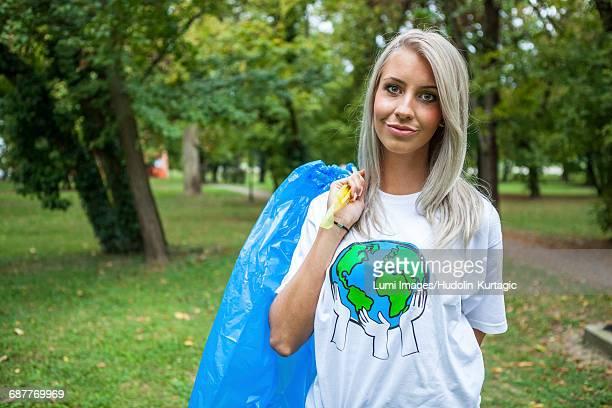 Teenage volunteer doing garbage cleanup in park
