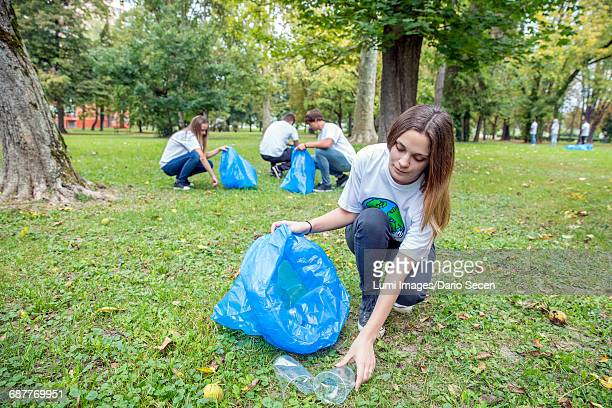 Teenage volunteers doing garbage cleanup in park