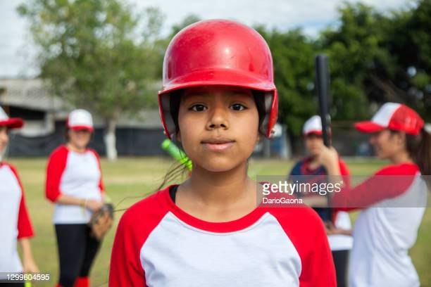 teenage woman baseball player - softball sport stock pictures, royalty-free photos & images