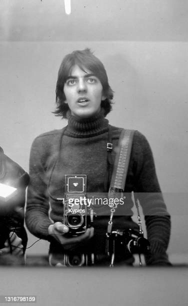 teenage young photographer using medium-format film camera - london, england, 1970s - design stock pictures, royalty-free photos & images
