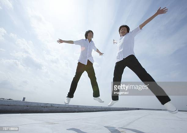 Teenageboys jumping on rooftop