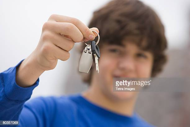 Teenaged boy holding car keys