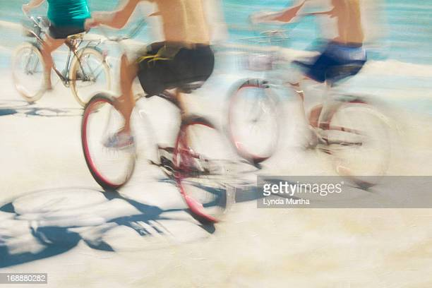 teenaged boys on bikes on the beach - fort myers stock pictures, royalty-free photos & images