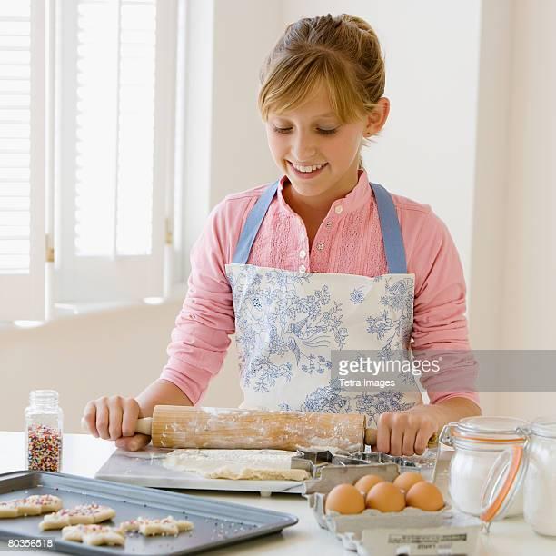 Teenaged girl baking cookies