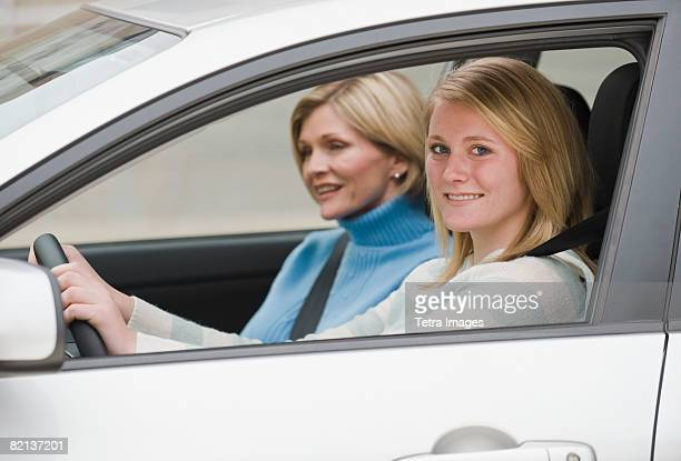 Teenaged Girl Driving With Mother