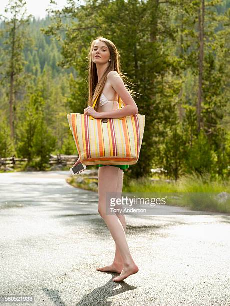 teenaged girl going to beach at mountain lake - bikini top stock pictures, royalty-free photos & images