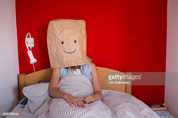 Teenaged girl hiding her feelings behind a paper bag on August 12 in Duelmen Germany Photo by Ute Grabowsky/Photothek via Getty Images