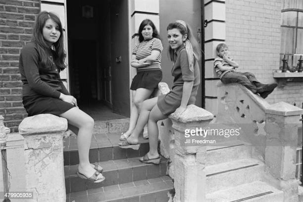 Teenaged girls outside a house in London England 1969