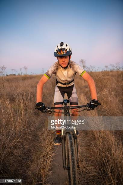 teenaged mtb rider at sunset in southern california - carlsbad california stock pictures, royalty-free photos & images