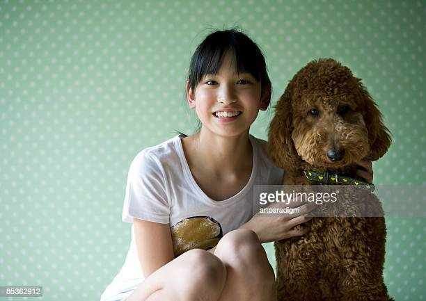 a teenagegirl and a dog - standard poodle stock photos and pictures