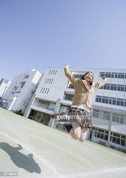 Teenagegirl jumping on open field