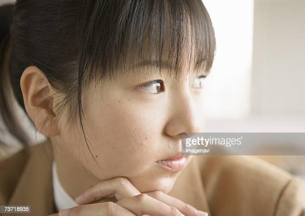 Teenagegirl resting head on hands