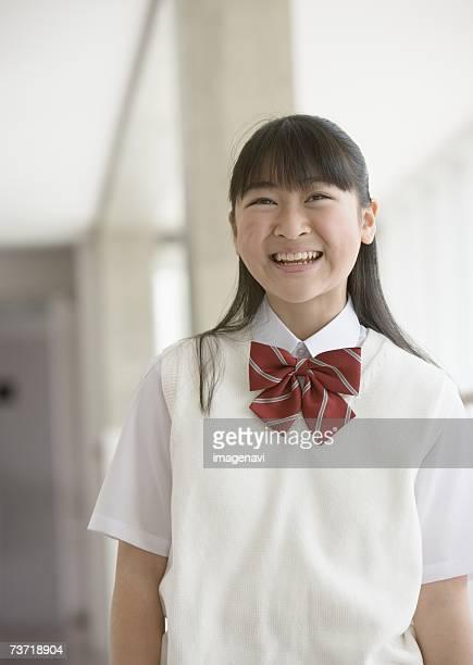 teenagegirl smiling in corridor - ベスト ストックフォトと画像