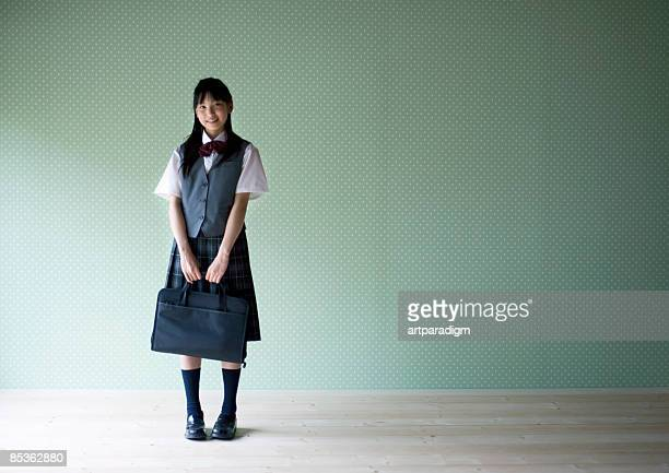 Teenagegirl smiling with wearing school uniform