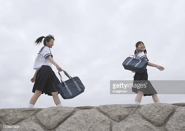 Teenagegirls walking on pier