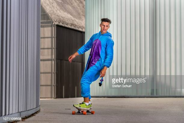 Teenager, 17 years, rides Longboard wearing a onepiece, Germany