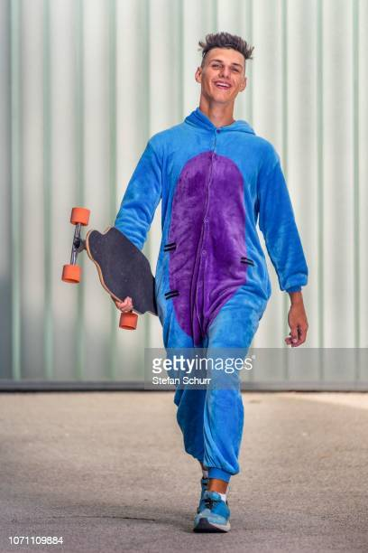 Teenager, 17 years, wearing a onepiece with longboard, Germany