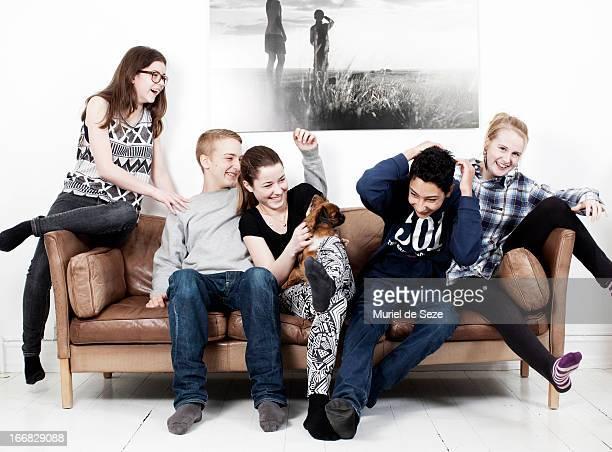 5 teenager and dog on sofa