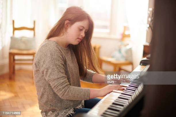 teenager at the piano - independence stock pictures, royalty-free photos & images