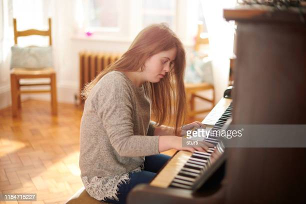 teenager at the piano - learning disability stock pictures, royalty-free photos & images