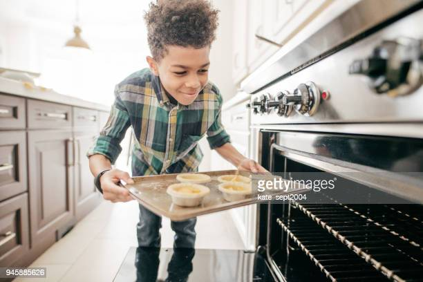 teenager baking cookies - pre adolescent child stock pictures, royalty-free photos & images