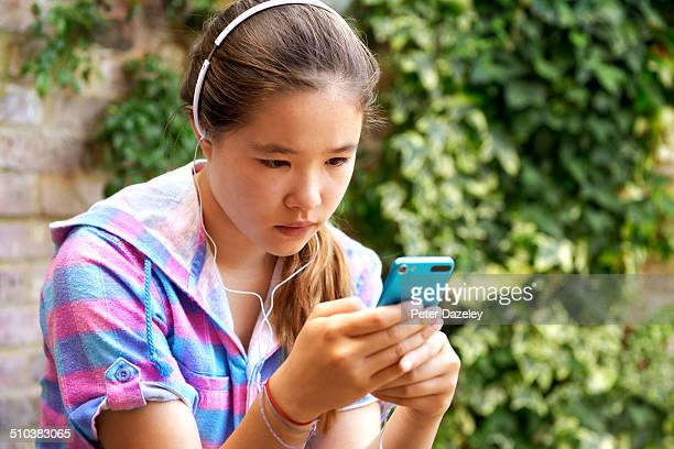 Teenager being bullied on smart phone