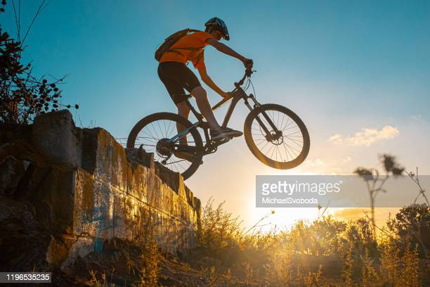 teenager boy mountain biking jumping - cross country cycling stock pictures, royalty-free photos & images