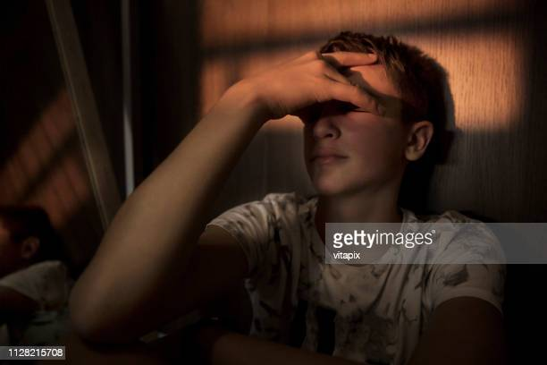 teenager boy under stress - teenage boys stock pictures, royalty-free photos & images