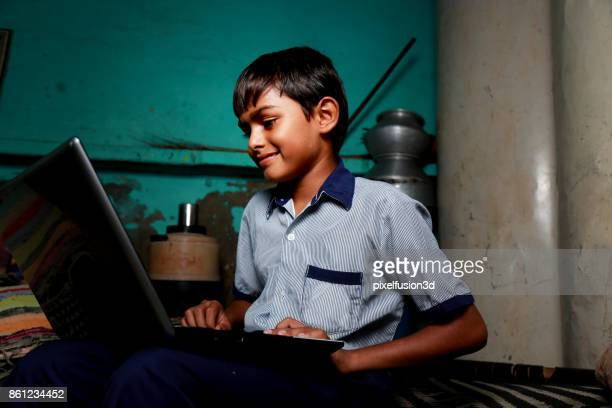 teenager boy using laptop - asian boy stock pictures, royalty-free photos & images