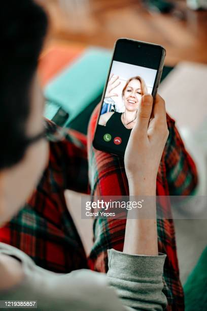 teenager boy video call at home with family during isolation - video still stock pictures, royalty-free photos & images